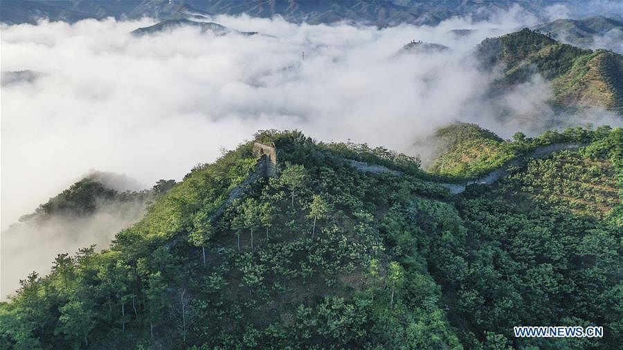 Aerial photo taken on Aug. 21, 2020 shows clouds swirling around the Great Wall in Zunhua City, north China's Hebei Province