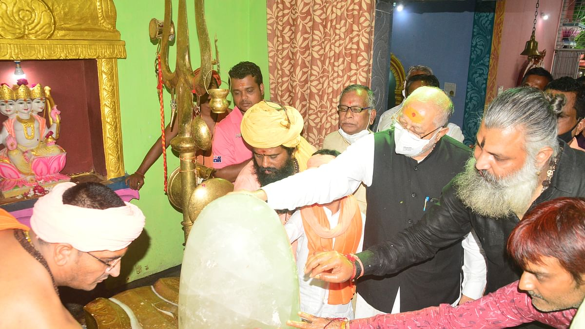 Prime Minister Narendra Modi's elder brother Prahalad Modi paying obeisance before the presiding deity at Ma Baglamukhi Dham in Ujjain on Tuesday.