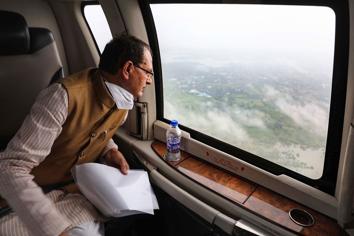 Madhya Pradesh Chief Minister Shivraj Singh Chouhan conducts an aerial survey of the flood-affected areas in the state.