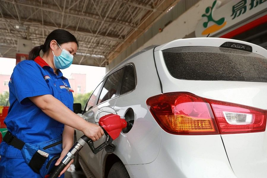 A staff member refuels a car at a gas station in Xingtai, north China's Hebei Province, June 28, 2020