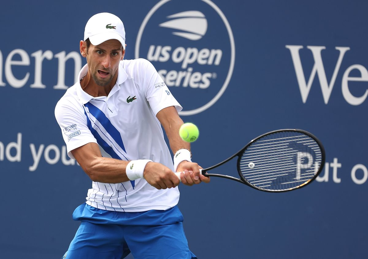 Djokovic advances, defending champ Medvedev ousted