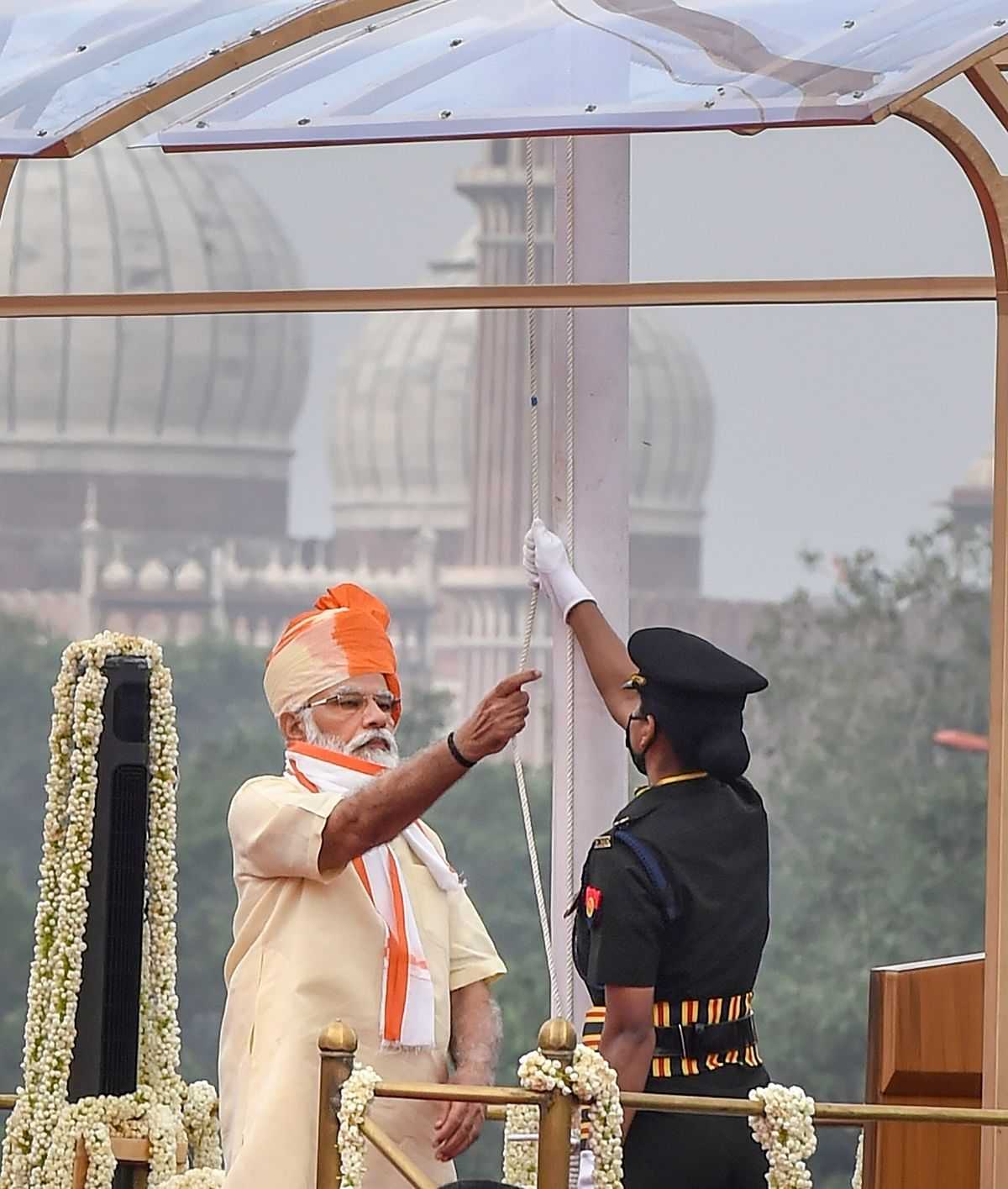 Prime Minister Narendra Modi unfurls the national flag during the 74th Independence Day celebrations, at Red Fort in New Delhi, Saturday, Aug. 15, 2020.