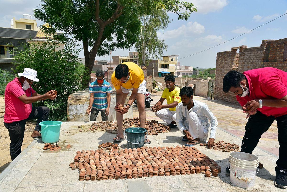 Devotees preparing of 5100 diya ahead of foundation laying ceremony of Ram Mandir in Ayodhya