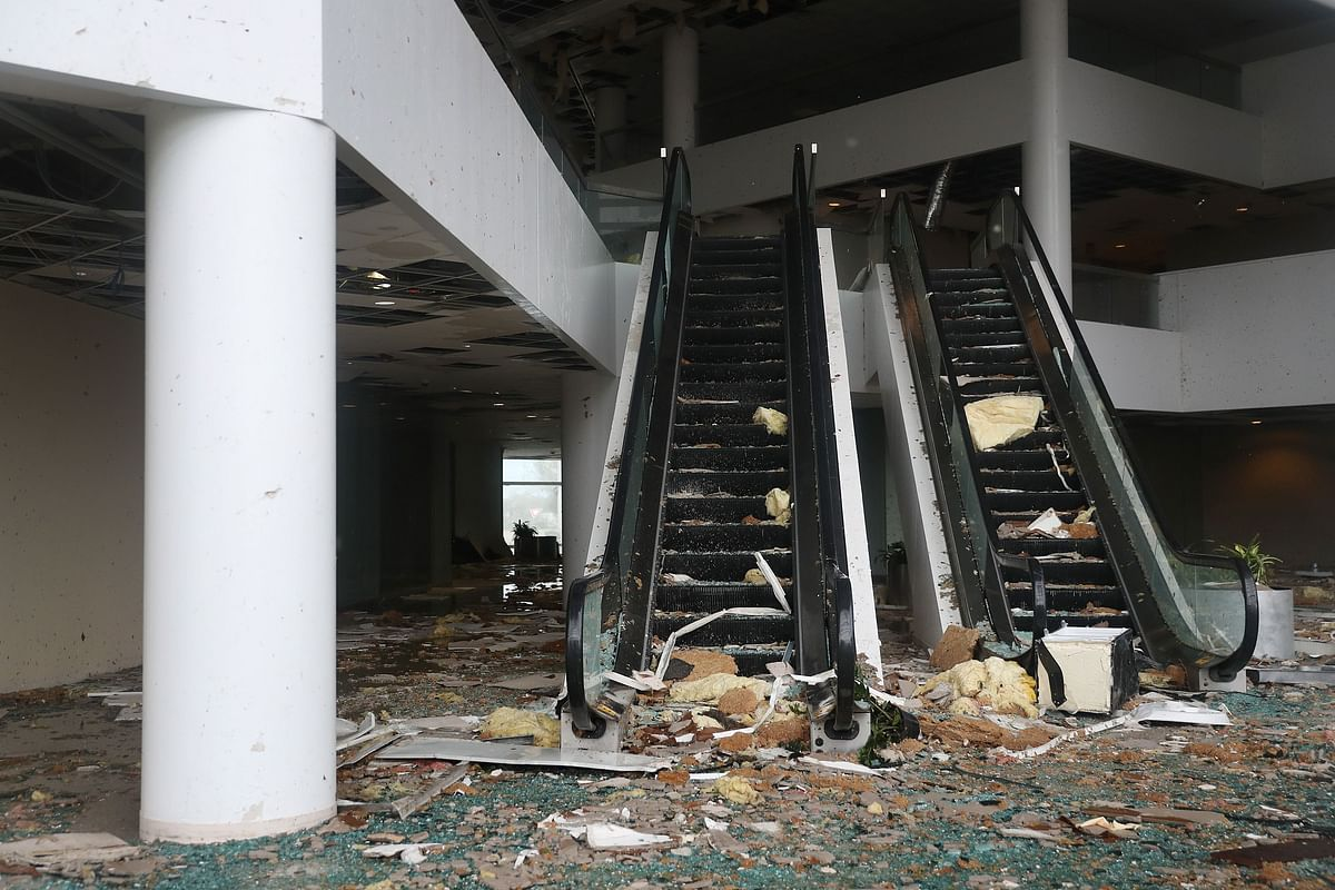 An escalator is seen in a building that had its windows blown in the downtown area after Hurricane Laura passed through on August 27, 2020 in Lake Charles, Louisiana
