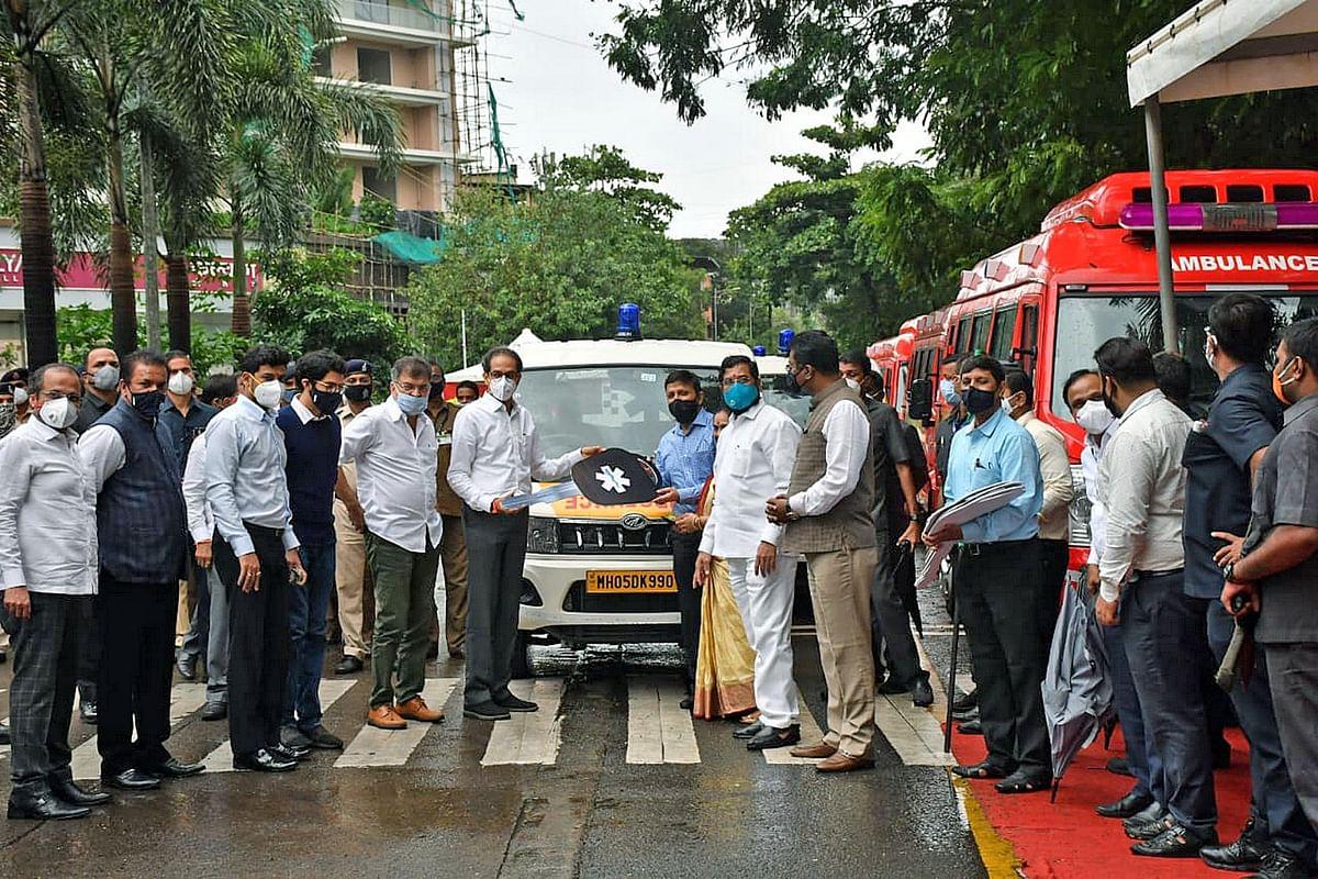 Maharashtra CM Uddhav Thackeray hands over ambulance keys to municipal corporations, in Thane on Monday.