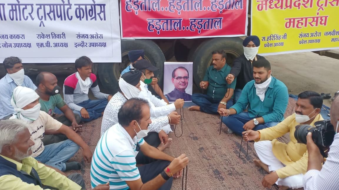 Members of Madhya Pradesh Transport Mahasangh of Pipliyarao Ring Road area stage protest in front of a photograph of the chief minister of Madhya Pradesh, Shivraj Singh Chouhan. They also chanted shlokas and mantras in protest.