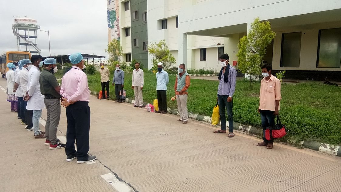 File Photo/ Doctors advice corona acers at the time of discharge from Maksi Road located facility, in Ujjain on Tuesday.
