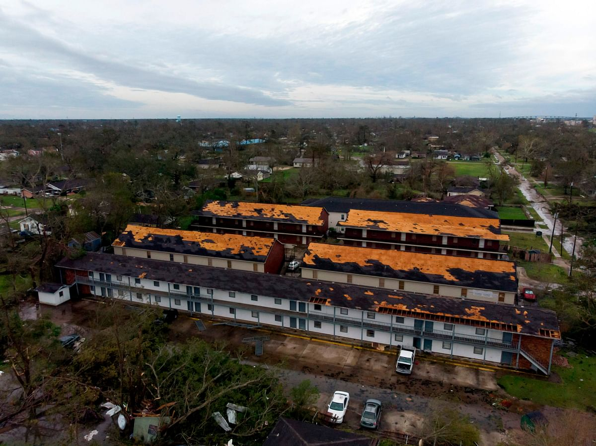 This aerial view shows damage caused by Hurricane Laura to the roof of an apartment complex on August 27, 2020 in Lake Charles, Louisiana.