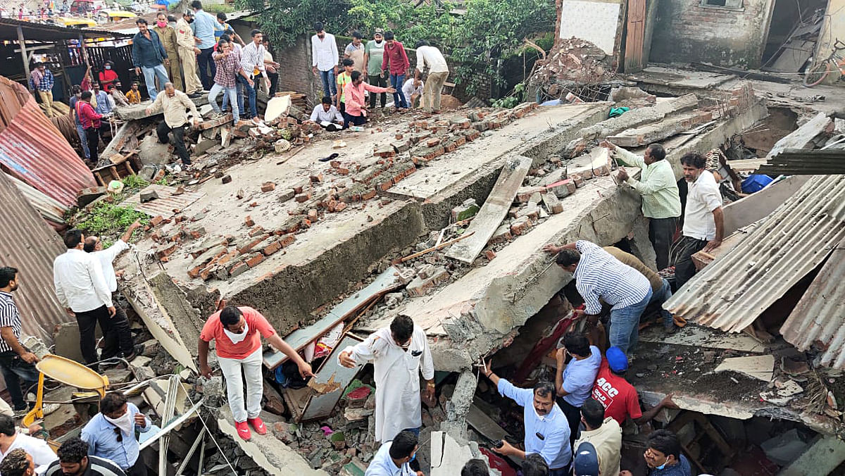 A two-storey building collapses near Lal Gate area at Dewas.
