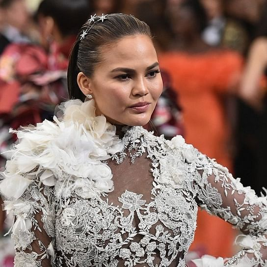 Pregnant Chrissy Teigen says she's been eating so much sour candy that her 'tongue is falling off'