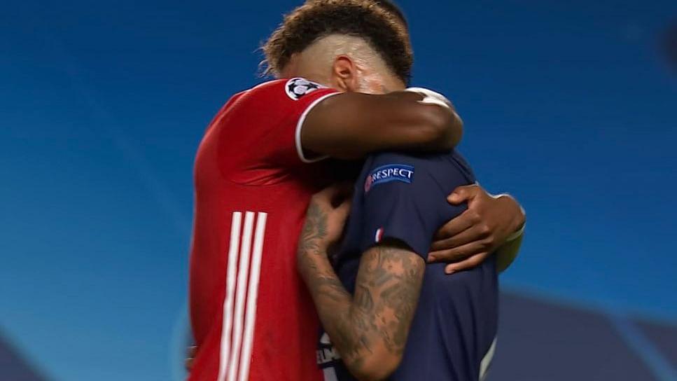 Bayern Munich's David Alaba consoles PSG's Neymar after the final whistle