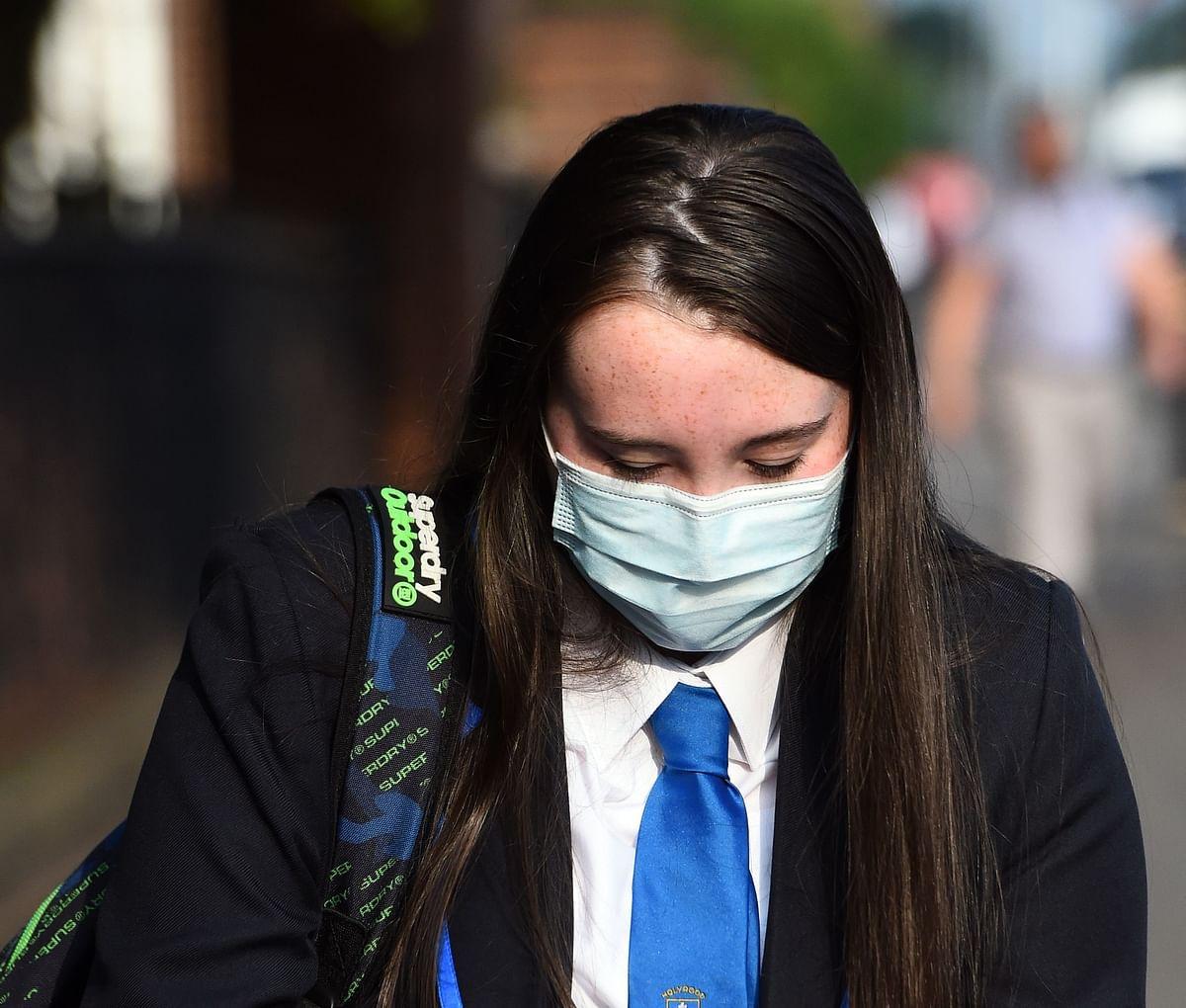 England makes face masks compulsory in schools