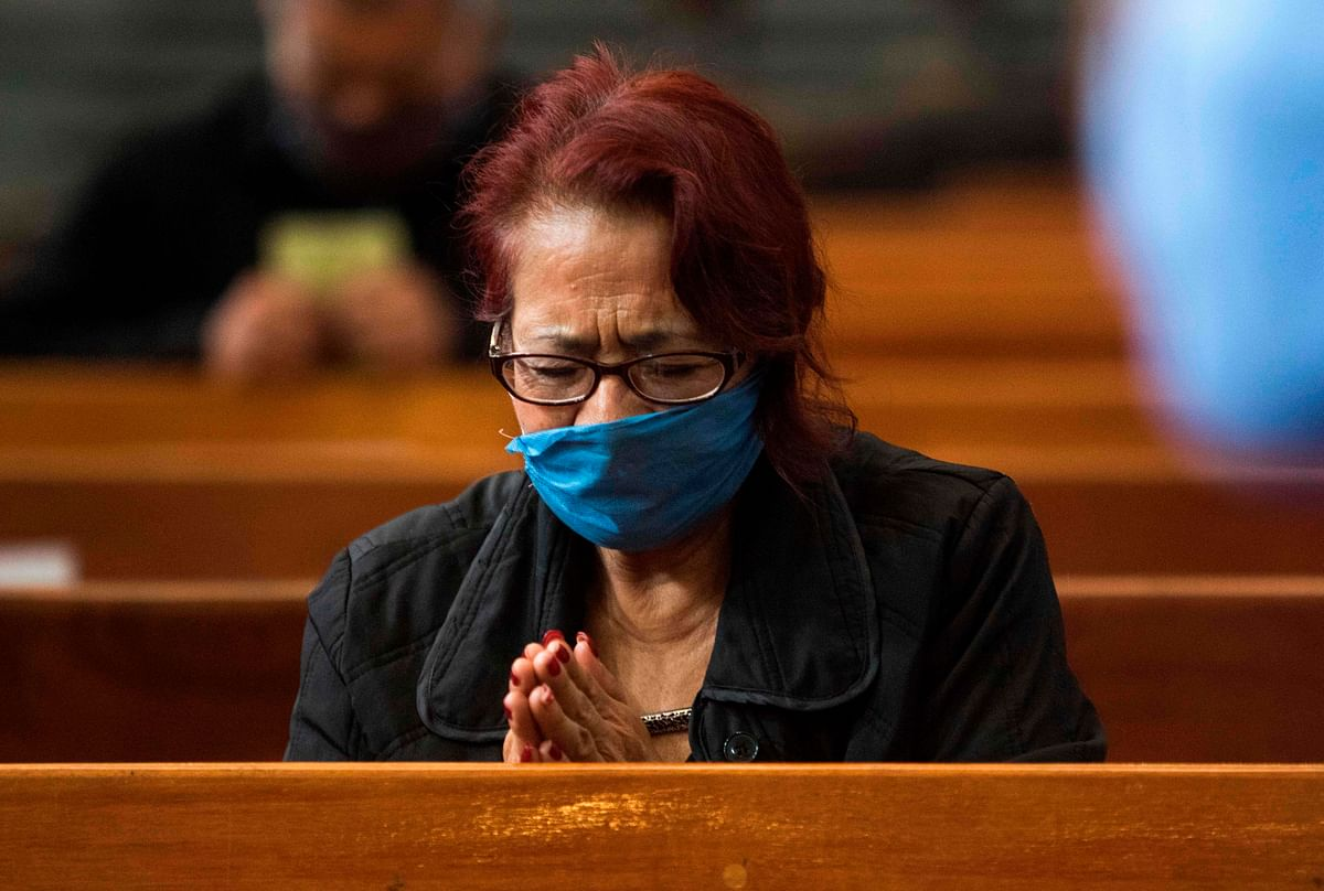 A devotee prays at Mexican church for a pandemic-free world.