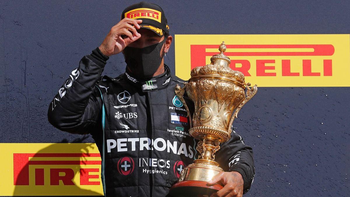 Despite puncture on last lap, Lewis Hamilton wins British Grand Prix for record 7th time