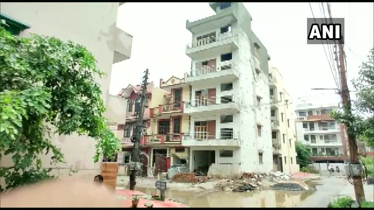 Police vacated a four-storey building in Gurugram's Sector-46 after it bent on one side, following heavy downpour in the region.