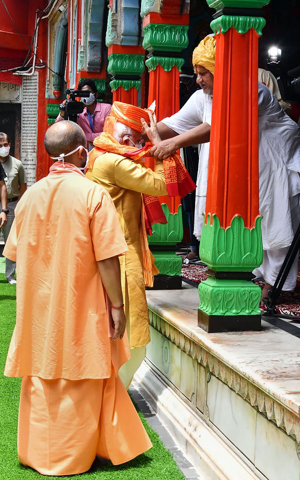 Prime Minister Narendra Modi along with Uttar Pradesh Chief Minister Yogi Adityanath being felicitated by a priest during his visit to Hanuman Garhi, in Ayodhya.