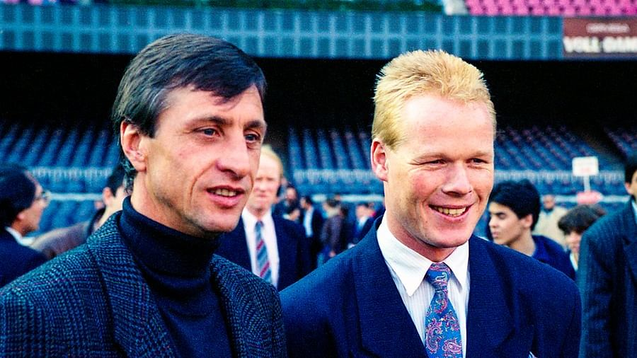 Barcelona legends Johan Cruyff (L) and Ronald Koeman (R)