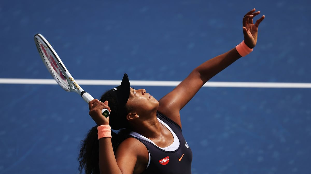Naomi Osaka of Japan serves against Anett Kontaveit of Estonia during the Western & Southern Open at the USTA Billie Jean King National Tennis Center on Wednesday