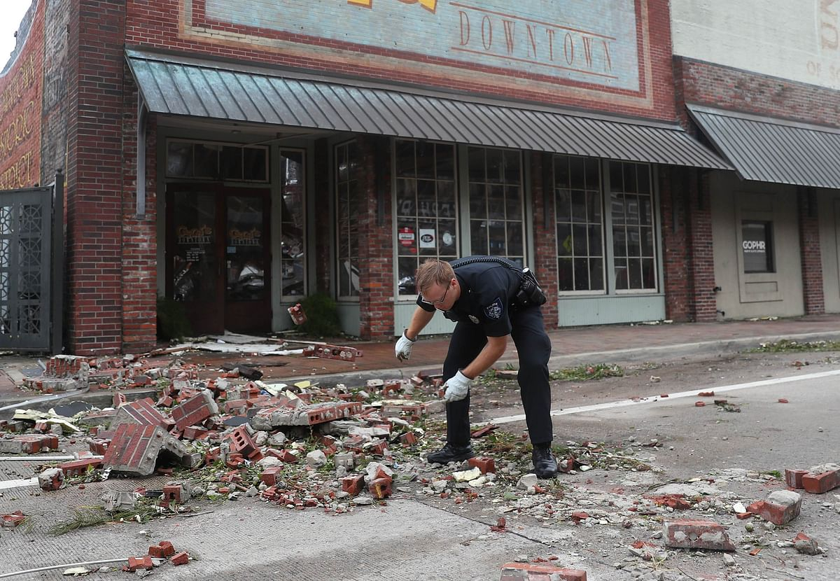 A Lake Charles police officer helps clear the streets in the downtown area after Hurricane Laura passed through on August 27, 2020 in Lake Charles, Louisiana