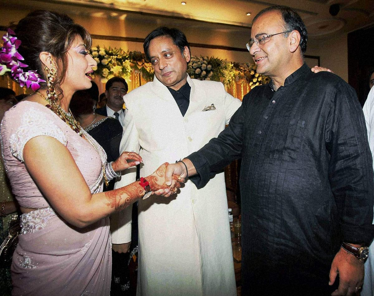 BJP leader Arun Jaitley greets newly wedded couple Shashi Tharoor and Sunanda Pushkar at their reception party in New Delhi in 2010.