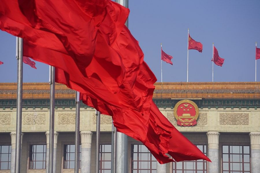 Photo taken on May 22, 2020 shows flags on the Tian'anmen Square and atop the Great Hall of the People in Beijing, capital of China.