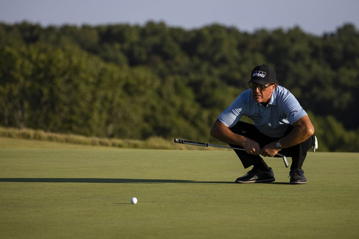 Phil Mickelson of the United States lines up a putt on the 15th green during the second round of the Charles Schwab Series at Ozarks National on Tuesday