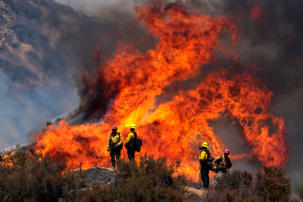 California is burning: 1,300 firefighters battle massive wildfire