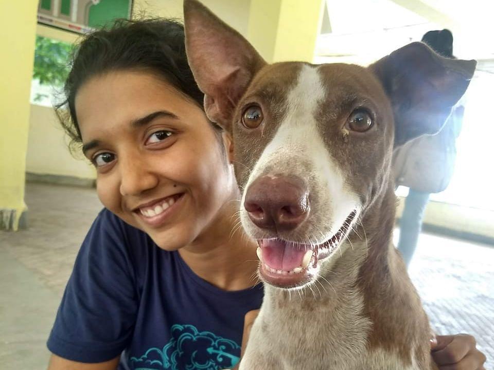 Aseem Pushpa Tara with a dog.