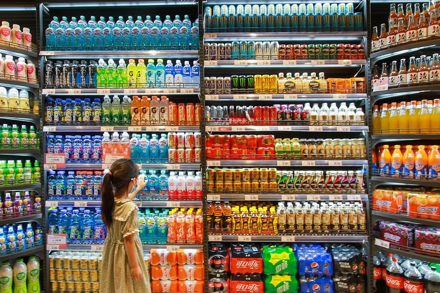 A child selets beverages at a supermarket in Handan City, north China's Hebei Province, July 9, 2020