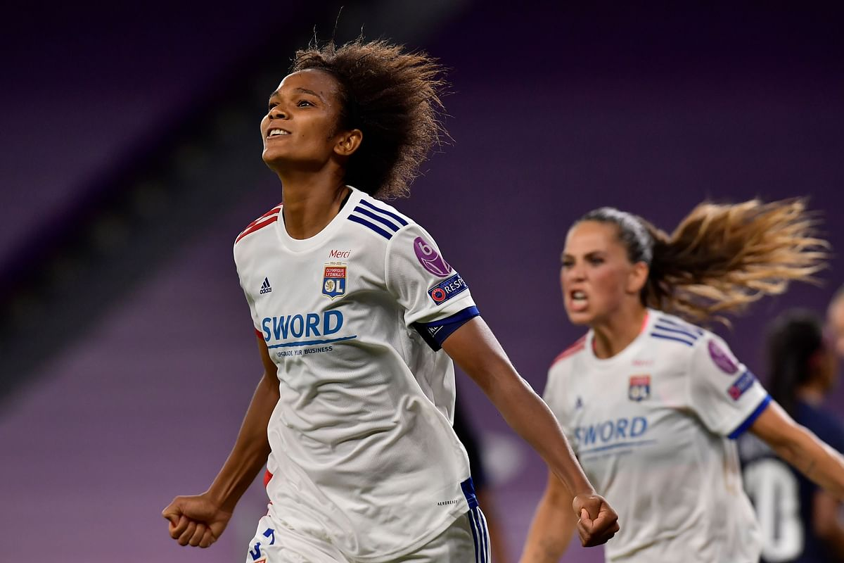 Lyon's French defender Wendie Renard celebrates after scoring a goal during the UEFA Women's Champions League semi-final football match between Paris Saint-Germain and Lyon at the San Mames stadium in Bilbao on  Wednesday