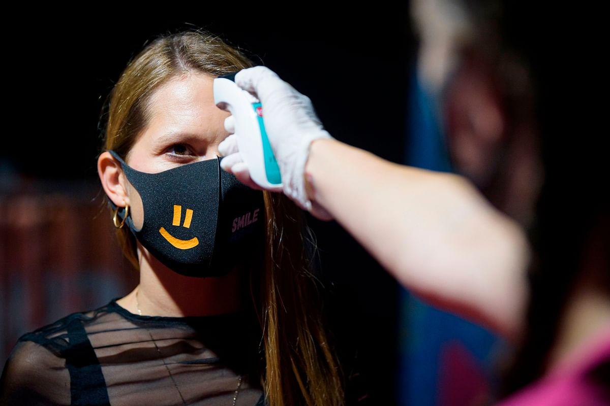 Singapore expands virus testing regime