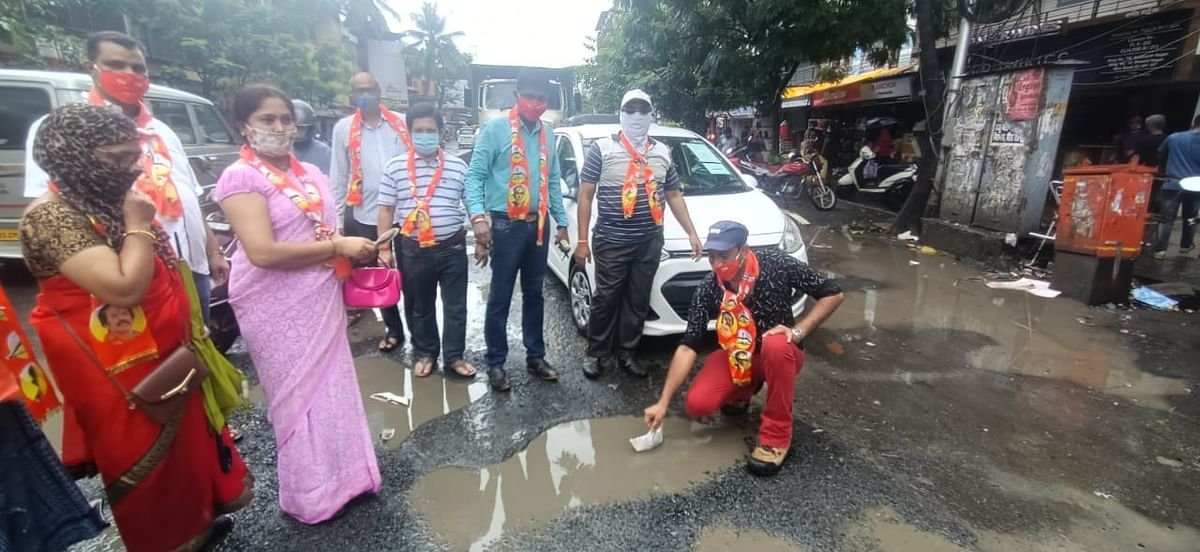 Mira Bhayandar: Shiv Sena workers float paper boats in pothole-filled roads as a mark of protest against BJP-led MBMC