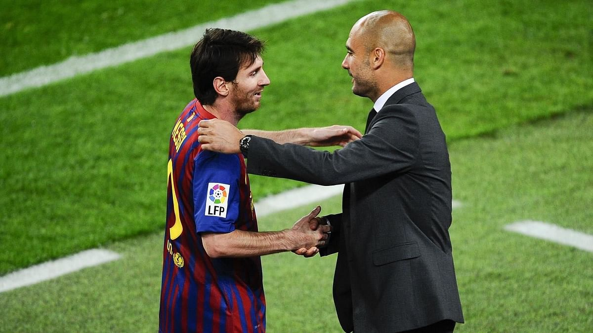 Lionel Messi (L) with Pep Guardiola