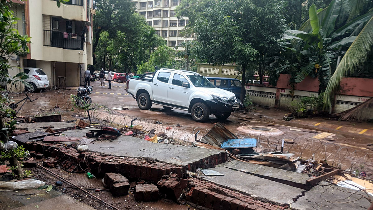 Heavy rainfall leads to wall collapse, tree falls and damaged vehicles in Thane