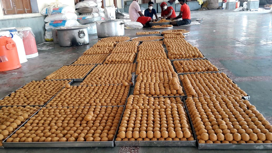 Workers preparing laddoos for Prasadam ahead of foundation laying ceremony of Ram temple