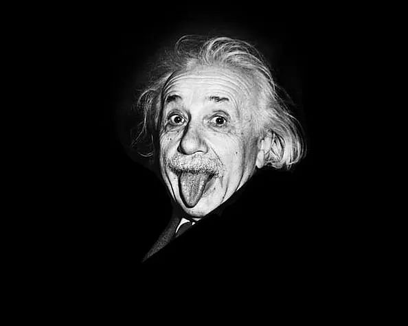 Albert Einstein sticks out his tongue for a photograph on this 72nd birthday.