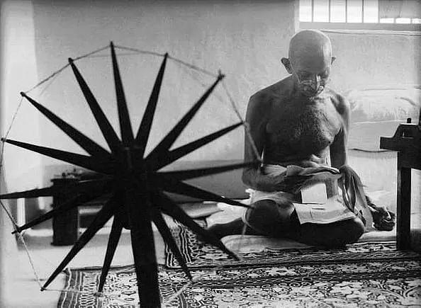 Mahatma Gandhi and his spinning wheel