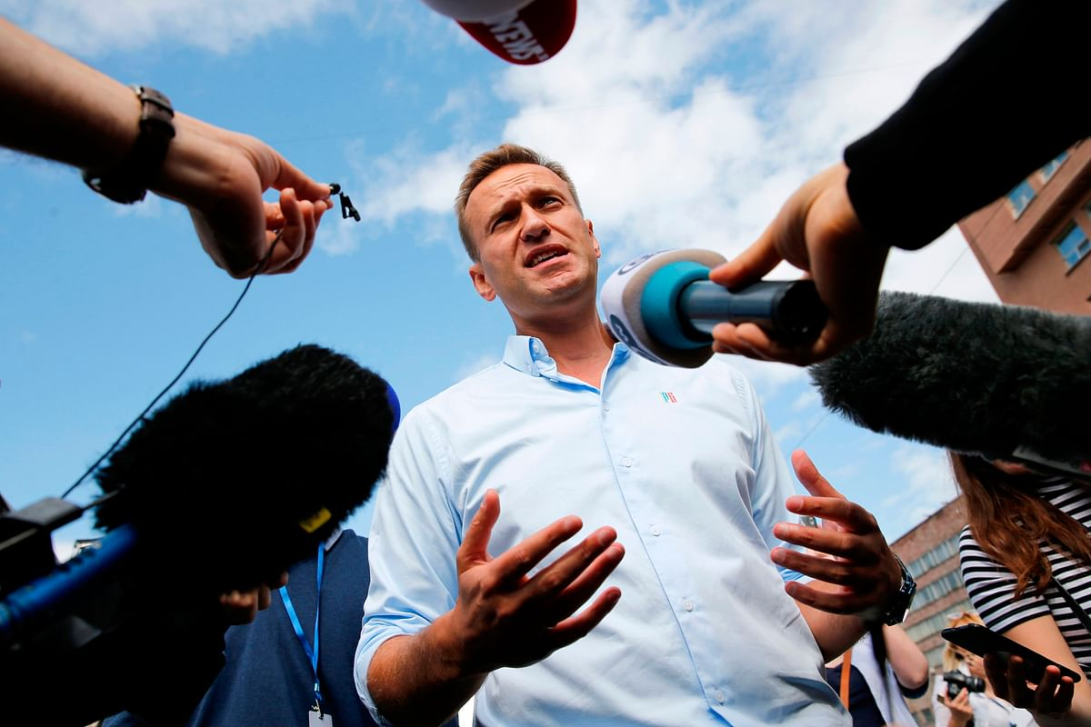 Russian opposition leader Alexei Navalny's condition improves, out of coma