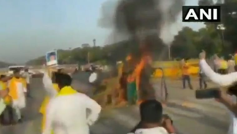 Farm bills protest take fiery turn: Tractor torched near Delhi's India Gate by alleged Cong workers