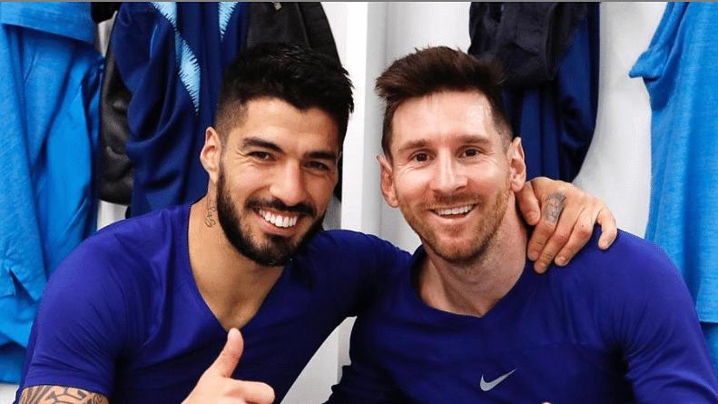 Luis Suarez (L) with Lionel Messi