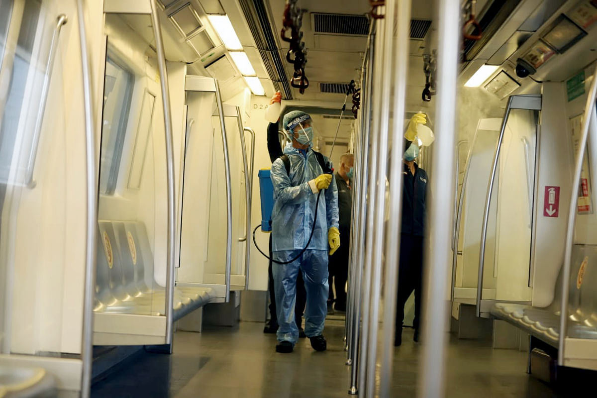 Preparation underway at the metro station as Delhi Metro rail gears up to resume services from Monday as part of Unlock 4, in New Delhi on Sunday.