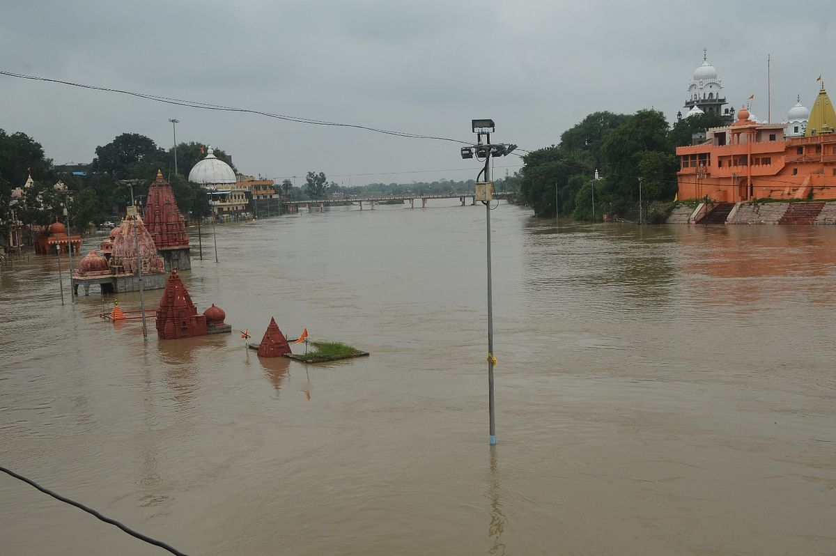Submerged temples at Ram Ghat of river Kshipra.