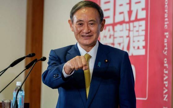 Newly elected leader of Japans Liberal Democratic Party (LDP) Yoshihide Suga gestures as he attends a press conference at the party's headquarters in Tokyo on September 14, 2020