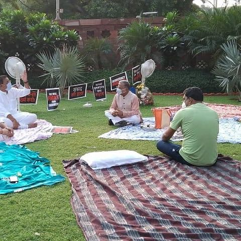 RS Deputy Chairman Harivansh brings tea for 8 suspended MPs who camped overnight at Parliament lawns