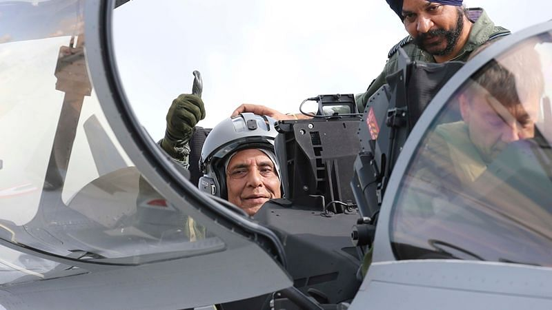 Defense Minister Rajnath Singh thumbs up as he sits in a Rafale jet fighter during an handover ceremony at the Dassault Aviation plant in Merignac, near Bordeaux, southwestern France.