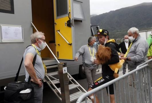 Slovenia's Primoz Roglic waits outside the doping control facility after the ninth stage of the Tour de France
