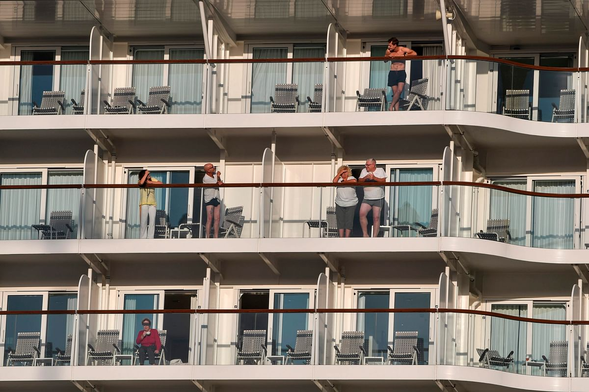 Passengers talk from their balconies aboard Maltese-flagged Mein Schiff 6, operated by German travel giant TUI.