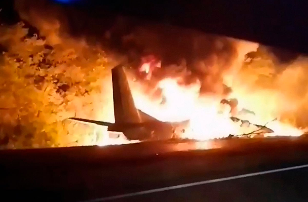 TV grab released by Ukraine's Emergency Situation Ministry shows an AN-26 military plane bursts into flames after it crashed in the town of Chuguyiv close to Kharkiv, Ukraine.