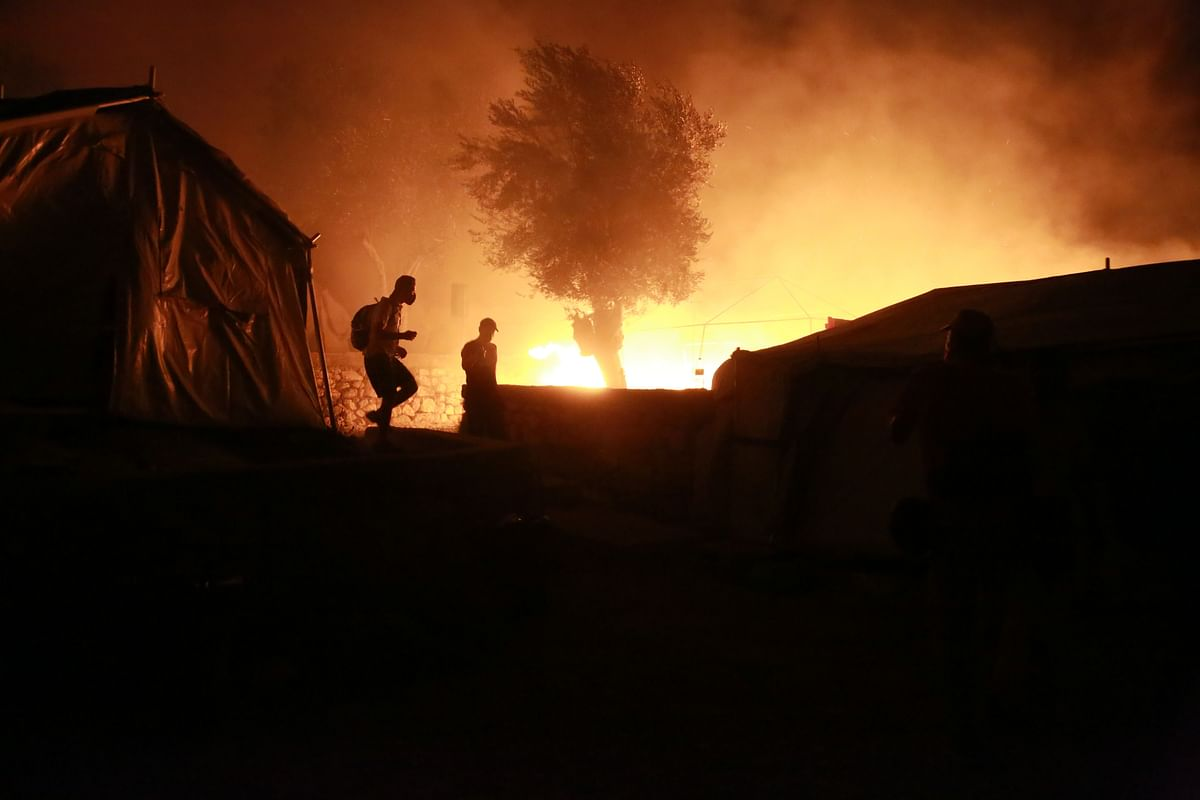 Over 12,000 migrants homeless as fire sweeps through Greek camp