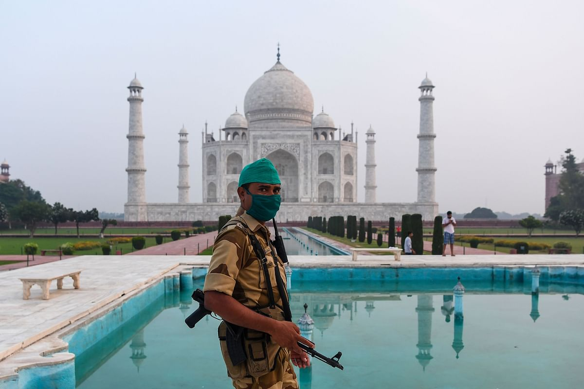 A security personnel patrols at the Taj Mahal in Agra on September 21, 2020. - The Taj Mahal reopens to visitors on September 21 in a symbolic business-as-usual gesture, even as India looks set to overtake the US as the global leader in coronavirus infections.